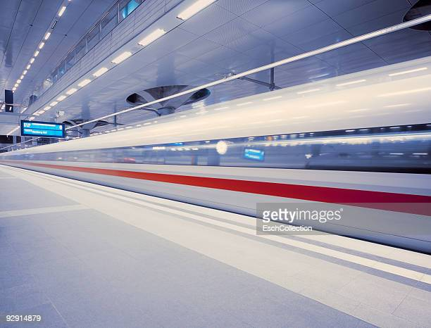 A fast ICE train leaving Berlin Central Station