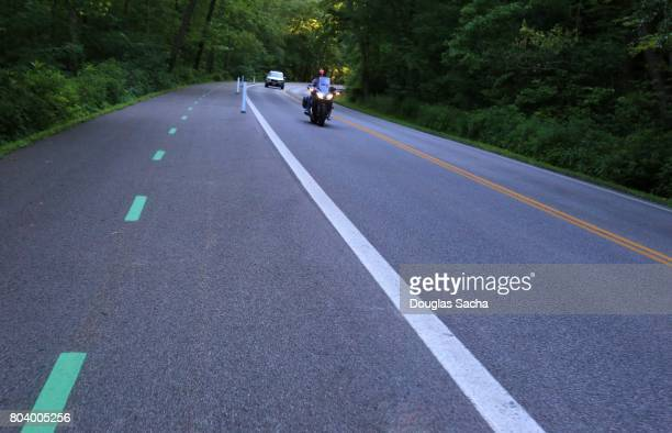 Fast moving motorcycle on a rural roadway