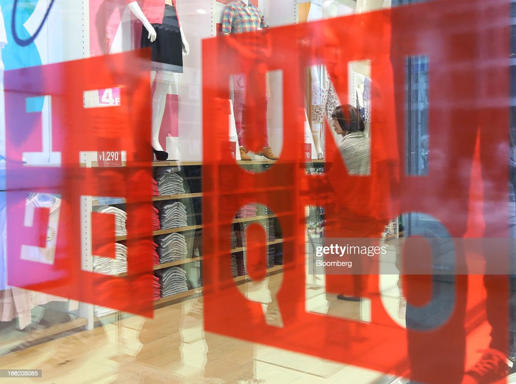 Fast Retailing Co.'s Uniqlo logo is displayed at the front of the store in the Ginza district of Tokyo, Japan, on Wednesday, April 10, 2013. Fast Retailing, Asia's largest apparel retailer, is scheduled to announce earnings tomorrow. Photographer: Yuriko Nakao/Bloomberg via Getty Images