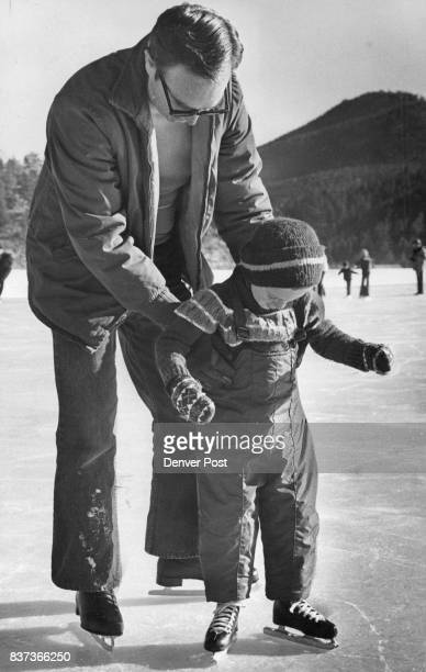 Fast ***** Wilbur Wagner helps his son Glen get his skate legs left on Evergreen Lake Glen takes off just fine on his own right on the popular...