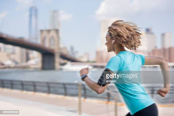Fast woman running in New York