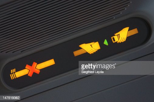 Fasten seatbelt sign on an aeroplane : Stock Photo