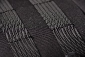 fastening slings malle on a black backpack macro