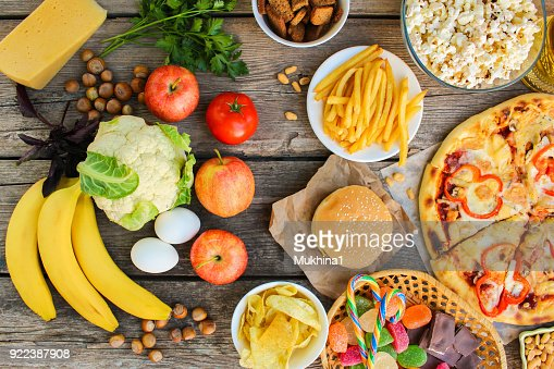 Fastfood and healthy food on old wooden background. Concept choosing correct nutrition or of junk eating. Top view. : Stock Photo