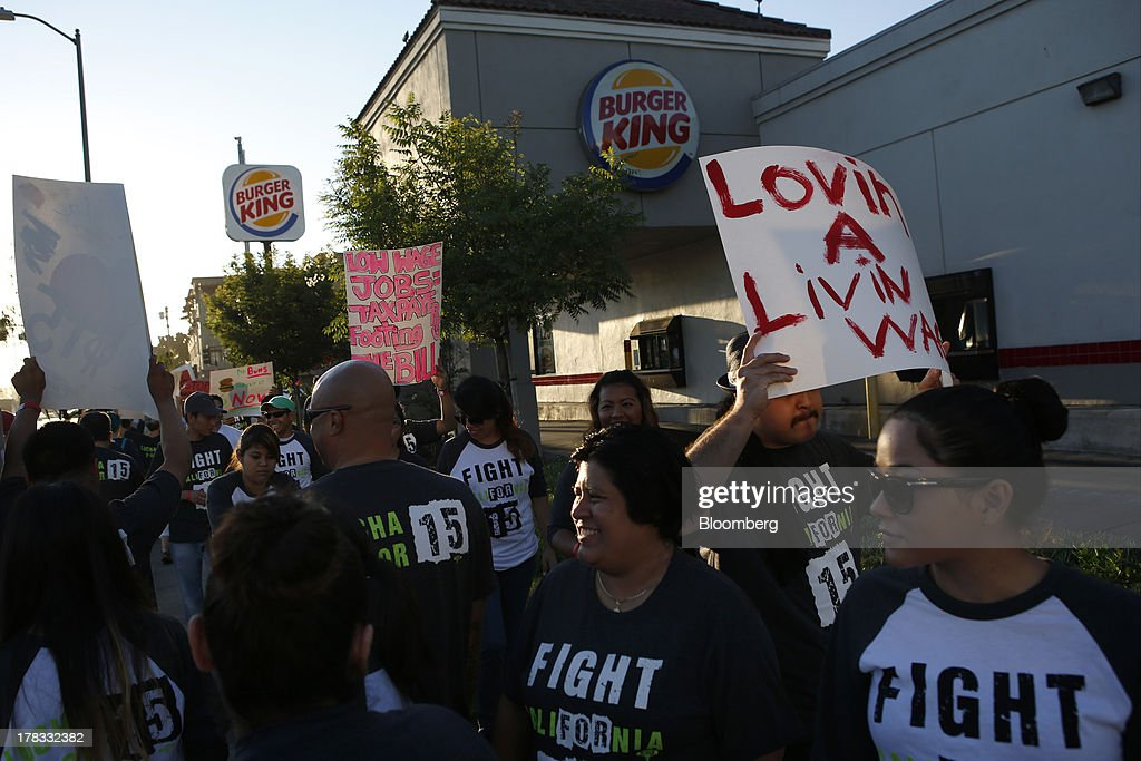 Fast-food workers and supporters organized by the Service Employees International Union (SEIU) protest outside of a Burger King Worldwide Inc. restaurant in Los Angeles, California, U.S., on Thursday, Aug. 29, 2013. Fast-food workers in 50 U.S. cities plan to walk off the job today, ratcheting up pressure on the industry to raise wages and demanding the right to wages of $15 an hour, more than double the federal minimum of $7.25. Photographer: Patrick T. Fallon/Bloomberg via Getty Images