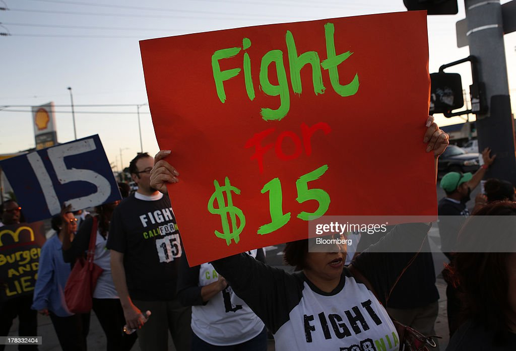 Fastfood workers and supporters organized by the Service Employees International Union protest outside of a Burger King Worldwide Inc restaurant in...