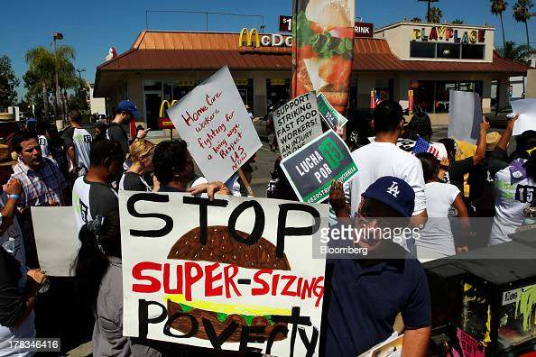 Fastfood workers and supporters organized by the Service Employees International Union protest outside of a McDonald's Corp restaurant in Los Angeles...