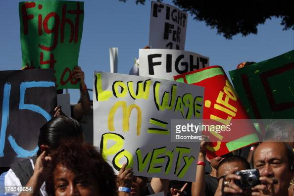 Fastfood workers and supporters organized by the Service Employees International Union protest on the streets of Los Angeles California US on...