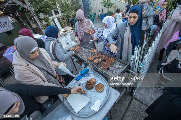 Fasting is over until the next time as worshipers flock to the Lakemba Mosque in suburban Sydney Australia Crowds spill into the street and...