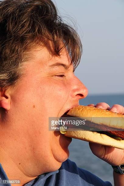 Gordo mulher comer Hambúrguer