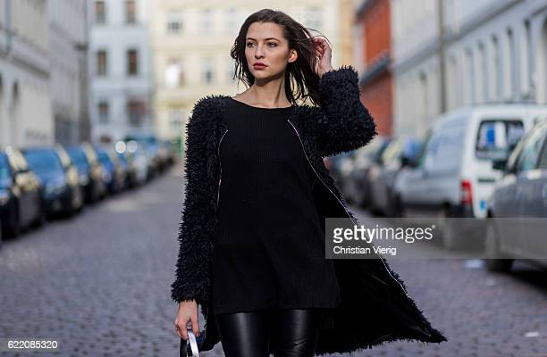 Fata Hasanovic wearing a black long fluffy jacket sassy classy black long shirt silver hand bag black leather pants from sassy classy on November 9...