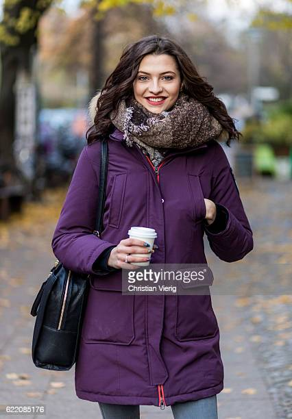 Fata Hasanovic wearing a sassy classy scarf a purple brekka parka jacket with hooded fur grey skinny Dr Denim jeans black Asos bag on November 9 2016...