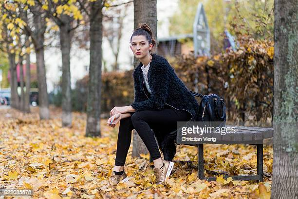Fata Hasanovic wearing black Asos bag a black fluffy coat from sassy classy a white laced top black skinny denim jeans golden Nike sneaker on...