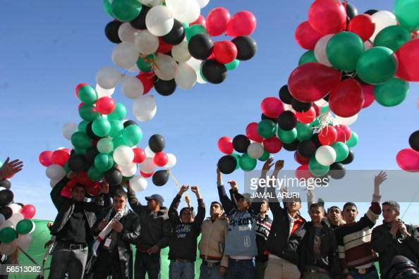 Fatah supporters release balloons in the air near the gravesite of late Palestinian leader Yasser Arafat in the West Bank city of Ramallah as the...