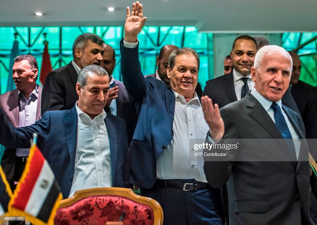 Fatah's Azzam al-Ahmad (R) head of the Fatah delegation for the talks, and Fatah's Rawhi Fattouh (2nd-R) are pictured after signing a reconciliation deal in Cairo on October 12, 2017, as the two rival Palestinian movements ended their decade-long split following negotiations overseen by Egypt. Under the agreement, the West Bank-based Palestinian Authority is to resume full control of the Hamas-controlled Gaza Strip by December 1, according to a statement from Egypt's government. /