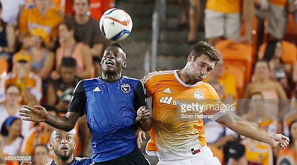 Fatai Alashe of the San Jose Earthquakes battles for the ball with Will Bruin of the Houston Dynamo during their game at BBVA Compass Stadium on...