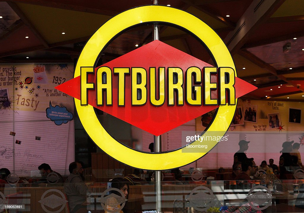 Fatburger signage is displayed at the company's outlet in Karachi, Pakistan, on Saturday, Jan. 5, 2013. Fatburger opened its first outlet in Pakistan to the public on Jan. 5. Photographer: Asim Hafeez/Bloomberg via Getty Images