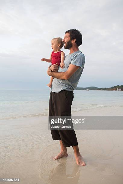 fatehr and baby son at the beach in thailand