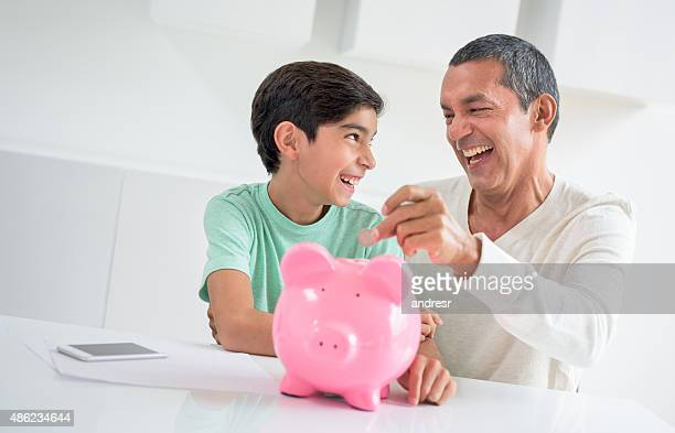 Father adding coins to his son's savings