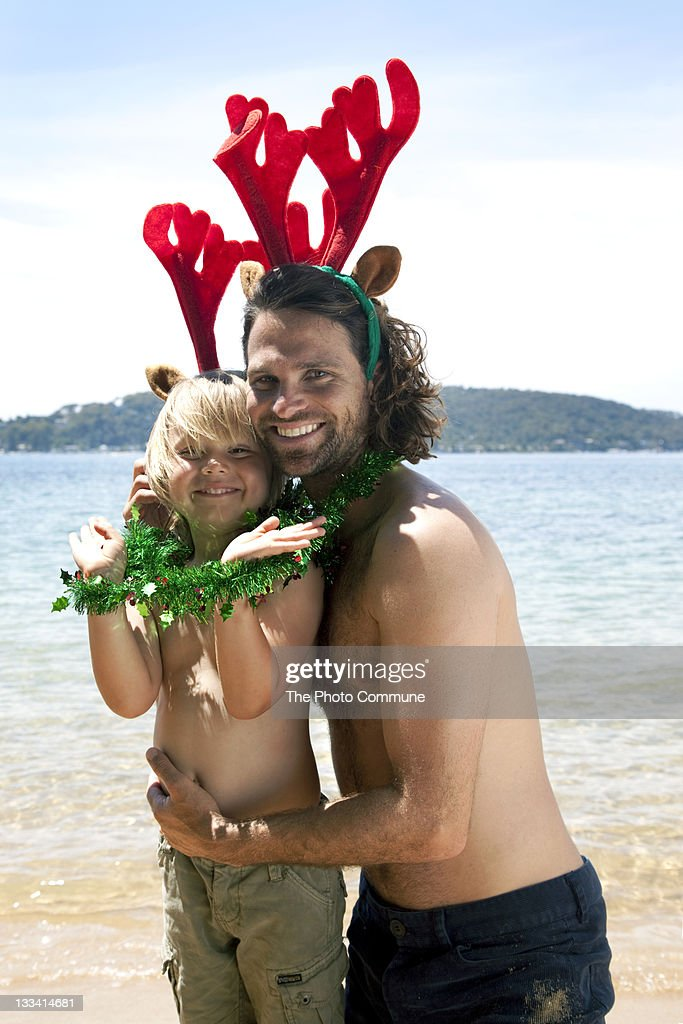 Father an son Australian Christmas on the beach : Stock Photo