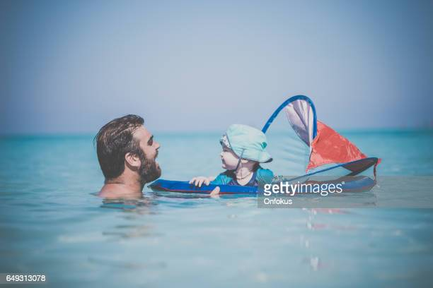 Father and Baby Boy Playing in Wayer on Tropical Beach