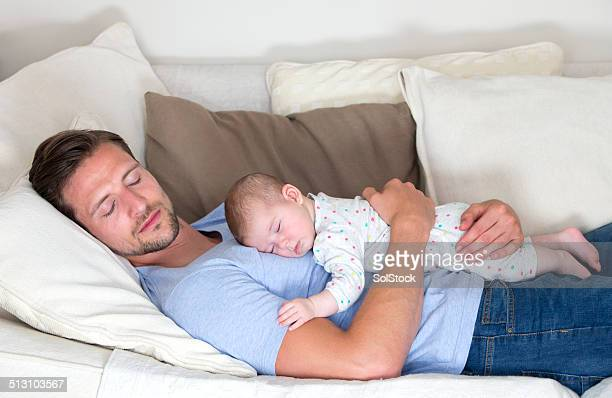 Father and Baby Daughter Sleeping