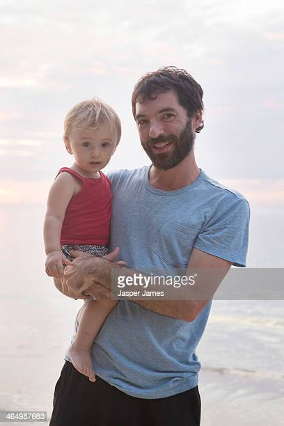 father and baby son at the beach in thailand