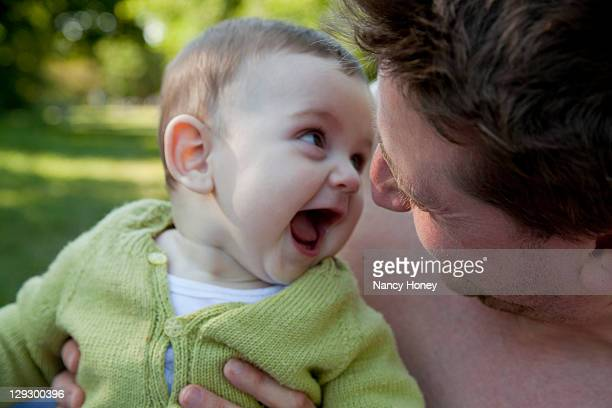 Father and baby son playing outdoors