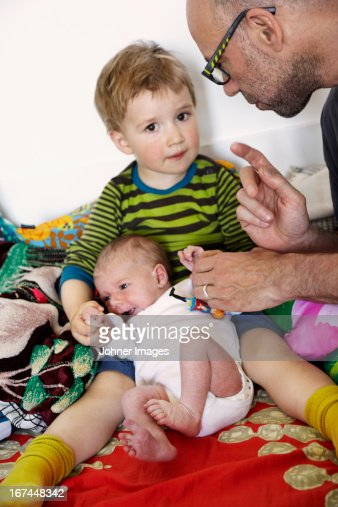 Father and boy with newborn baby : Stock Photo