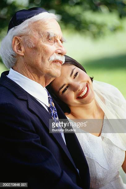 Father and bride sitting outdoors