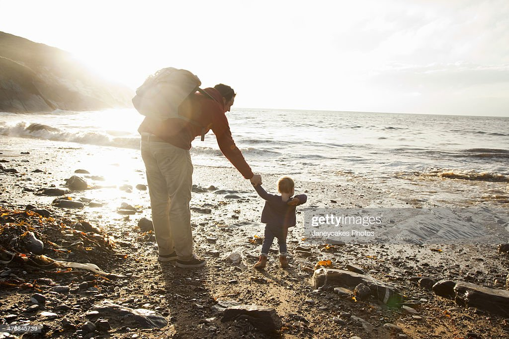 Father and child enjoying beach : Stock Photo