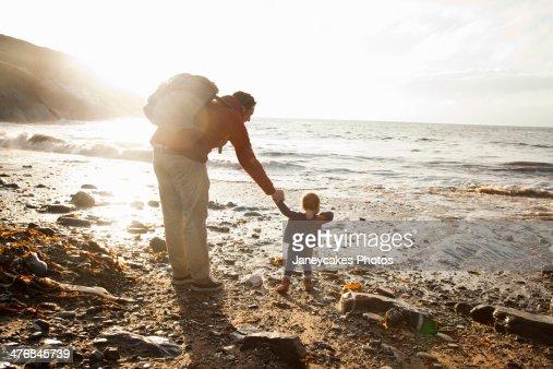 Father and child enjoying beach : Stock Photo