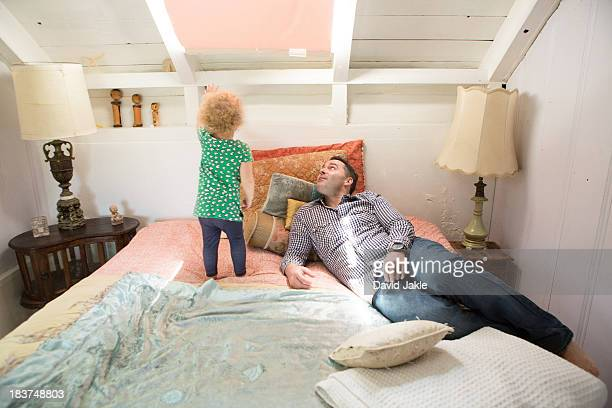 Father and child looking at ceiling