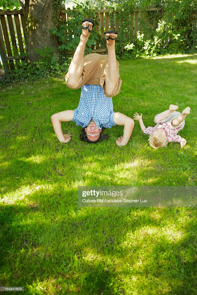 Father and child playing in backyard : Stock Photo