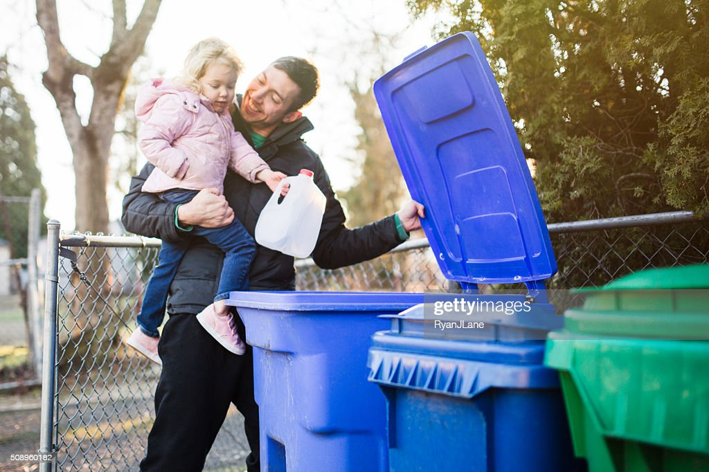 Father and Child Taking Out Recycle Trash : Stock Photo