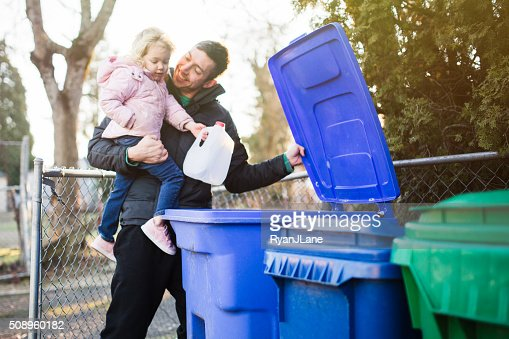Father and Child Taking Out Recycle Trash