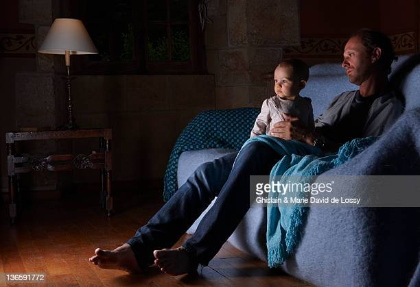 Father and child watching television