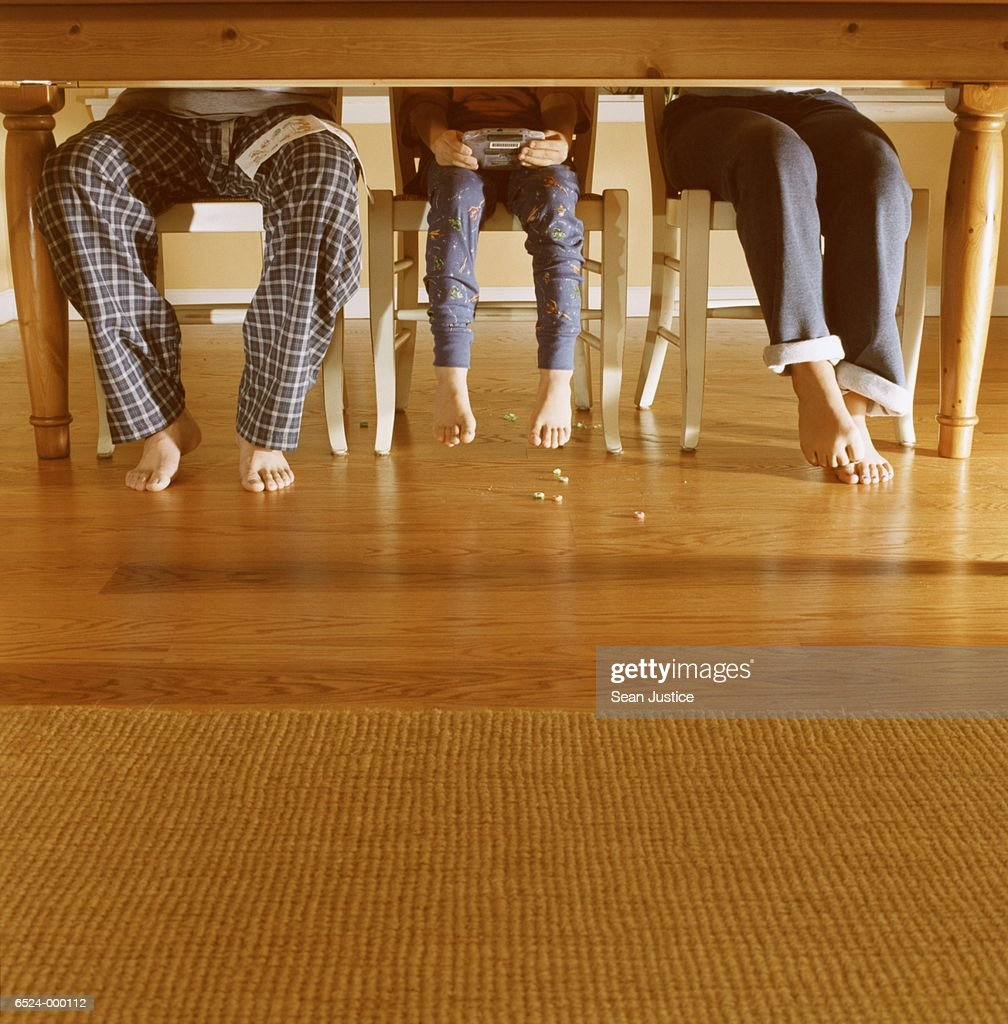 Father and Children at Table : Stock Photo
