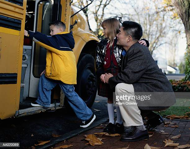 Father and Children at the School Bus