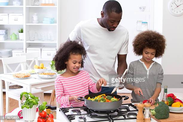 Father and Children Cooking Family Meal