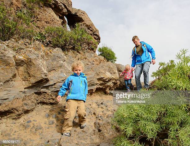 Father and children hiking in the mountains