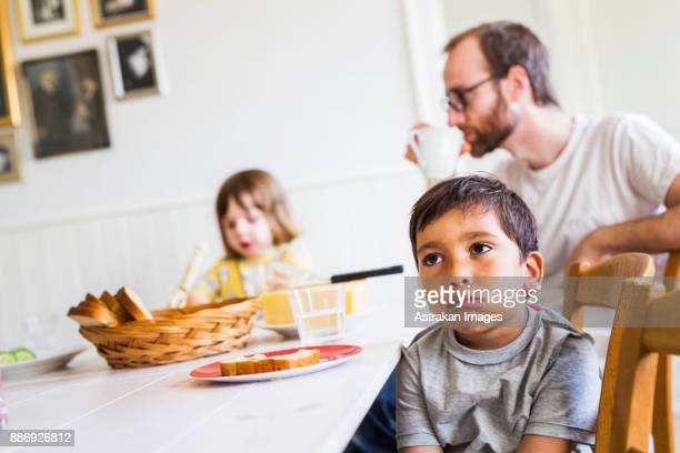 Father and children (2-3) in dining room