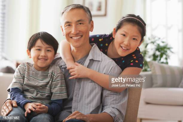 Father and children smiling together