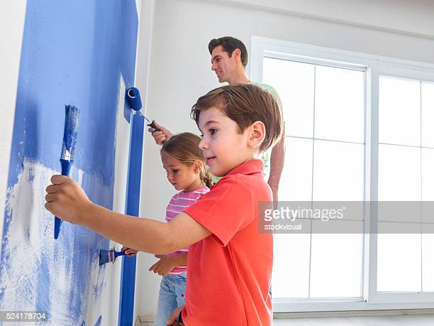 Father and childs painting wall