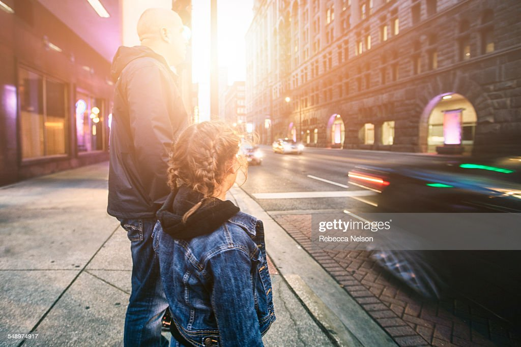 father and daughter about to cross street : Stock Photo