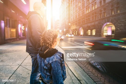 father and daughter about to cross street