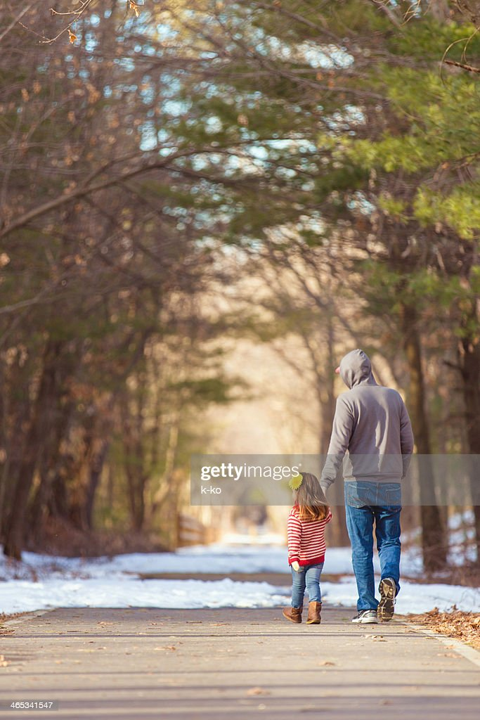 Father and Daughter at a play ground : Stock Photo