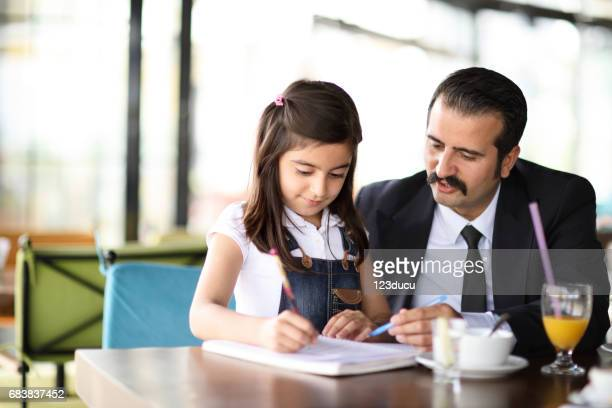Father And Daughter At Cafe