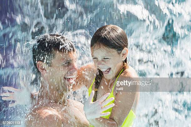 Father and daughter at water park