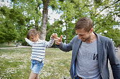 Father and daughter balancing outdoors